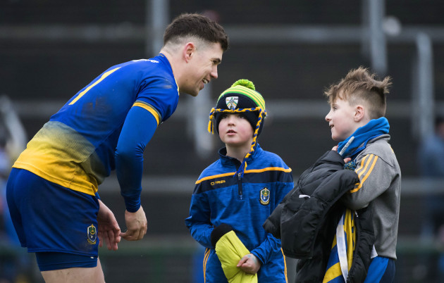 Darren O'Malley with young fans after the game