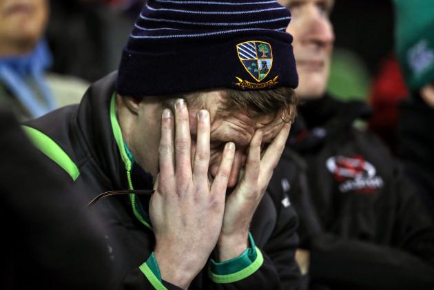 An Ireland fan dejected late in the game