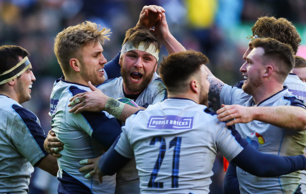 Chris Harries celebrates scoring their fifth try with teammates