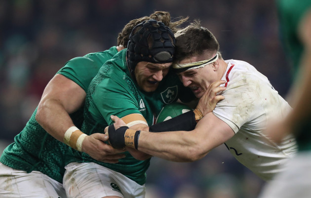 Ireland's Sean O'Brien is tackled by England's Tom Curry