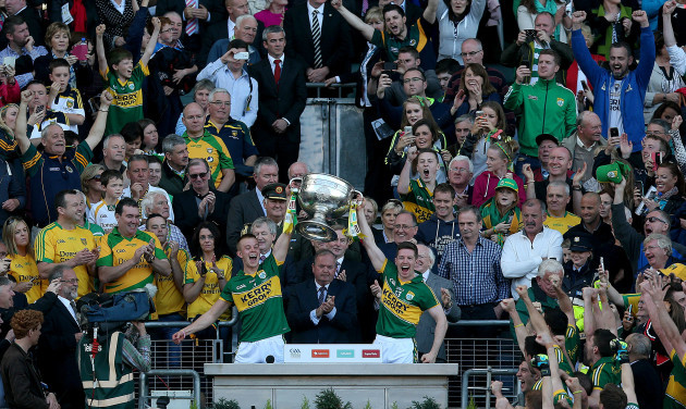 Fionn Fitzgerald and Kieran O'Leary lift The Sam Maguire cup