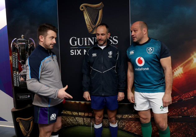 Greig Laidlaw and Rory Best with Romain Poite at the coin toss