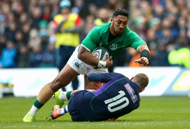 Bundee Aki is tackled by Finn Russell