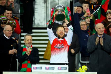 Brendan Kelly lifts the trophy