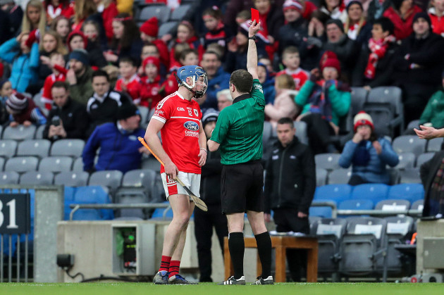 Jack Doyle receives a red card from Colum Cunning