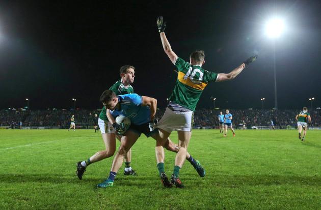 Tadgh Morley and Diarmuid O'Connor tackle Brian Howard