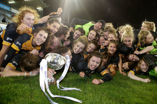 Mourneabbey's players celebrate with the trophy
