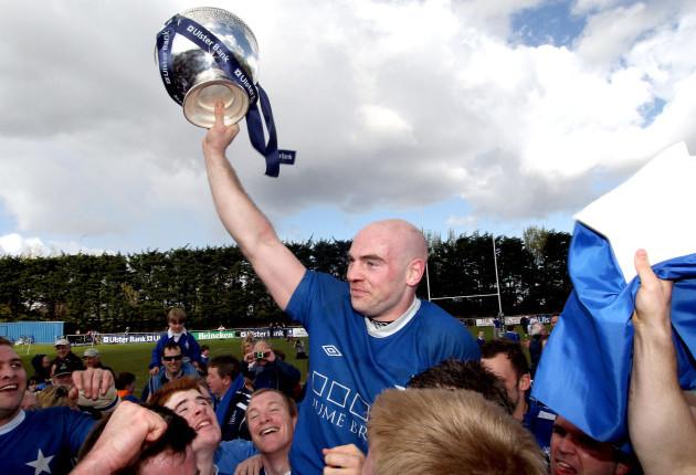 Hugh Hogan lifts the trophy