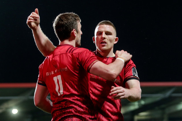 Darren Sweetnam celebrates scoring a try with Andrew Conway