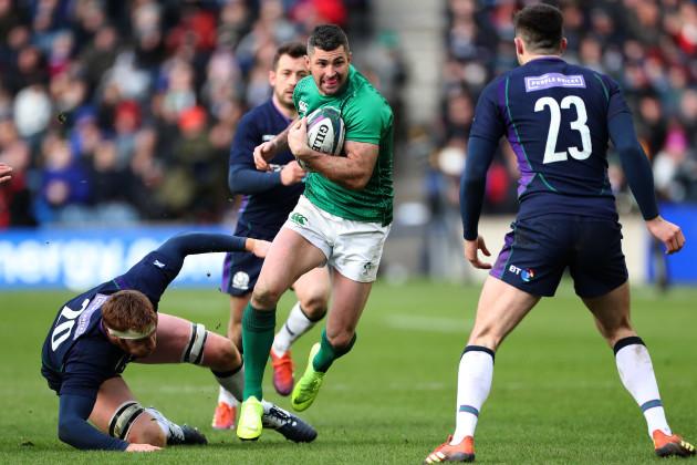 Ireland's Rob Kearney is tackled by Scotland's Rob Harley