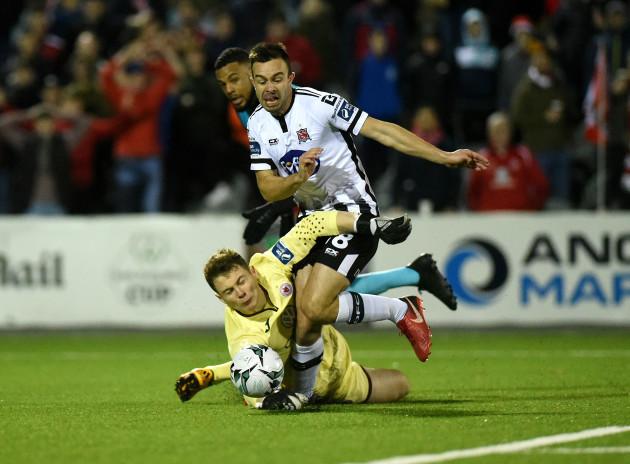 Robbie Benson is fouled by Sligo Rovers goalkeeper Edward McGinty