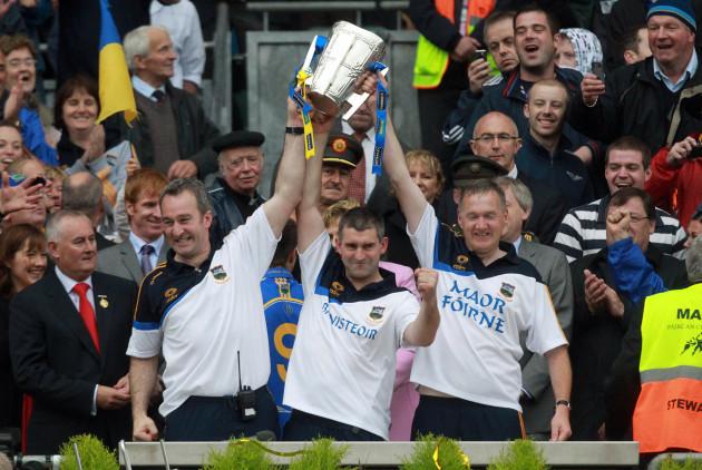 Michael Ryan, Liam Sheedy and Eamon O'Shea lift the Liam McCarthy Cup
