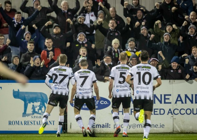 Dundalk players celebrate Michael Duffy's goal with the fans
