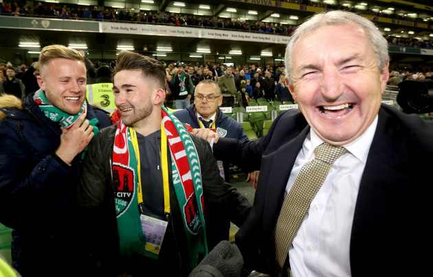 John Caulfield celebrates with former players Kevin O'Connor and Sean Maguire
