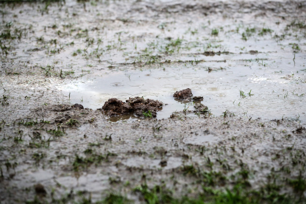 A view of the waterlogged pitch which caused the game to be postponed