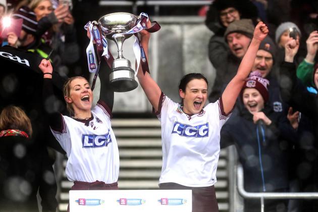 Grainne O'Kane and Siobhan Bradley lift the trophy
