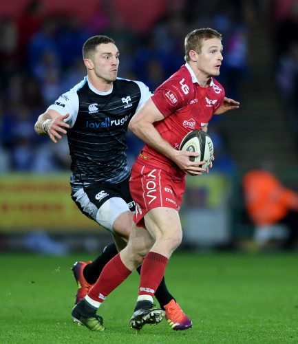 Johnny McNicholl is tackled by George North