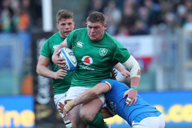Ireland's Tadhg Furlong is tackled by Italy's Leonardo Ghiraldini