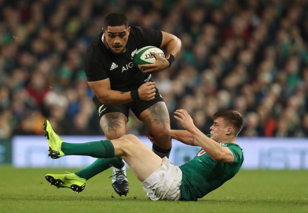 New Zealand's Ofa Tuungafasi is tackled by Ireland's Garry Ringrose