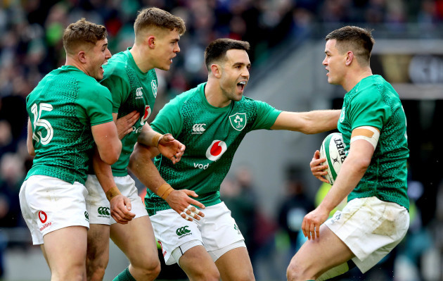 Jonathan Sexton celebrates scoring their second try with Jordan Larmour, Garry Ringrose and Conor Murray