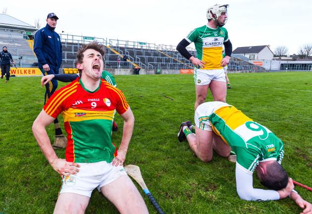 Sean Whelan celebrates winning while Pat Camon and Sean Dolan look on dejected
