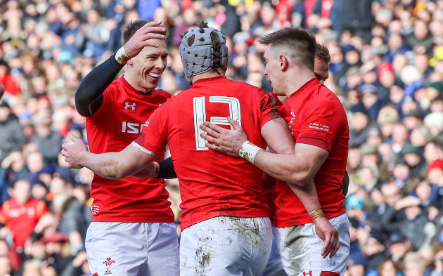 Jonathan Davies celebrates scoring their second try with Josh Adams and Liam Williams