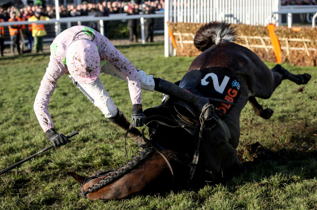 Rugby Walsh falls off Benie Des Dieux during the OLBG Mares' Hurdle