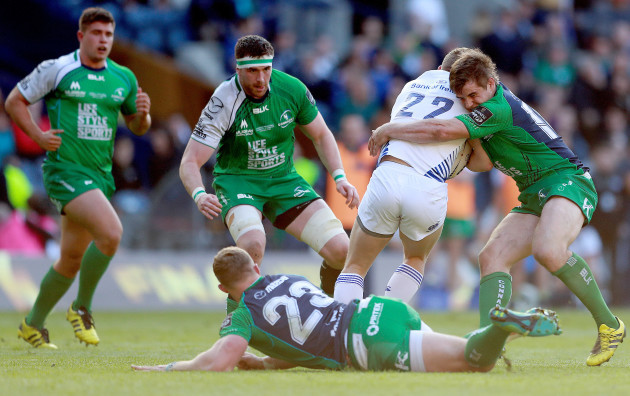 Andrew Browne and AJ MacGinty tackle Ian Madigan