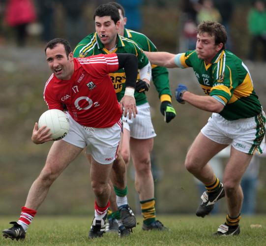 David Geaney and Donnacha Walsh tackle Kieran O'Connor