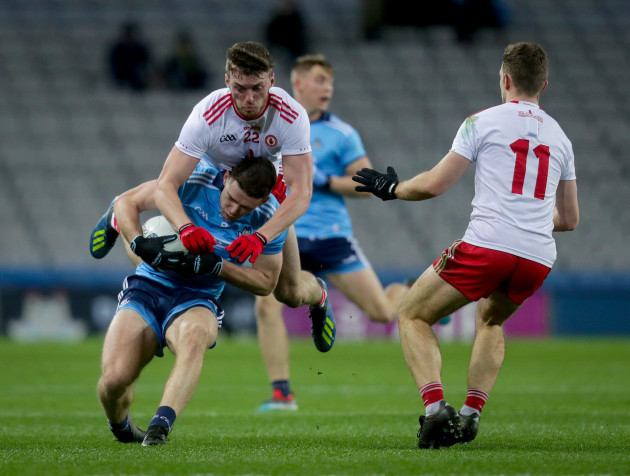 Brian Fenton is tackled by Brian Kennedy