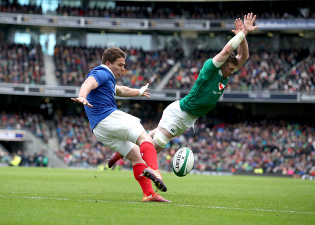 Peter O'Mahony charges down Antoine Dupont's kick