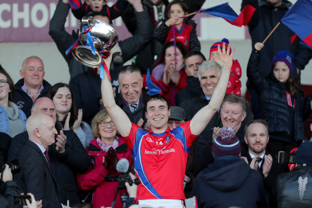 Conor Cooney lifts the trophy