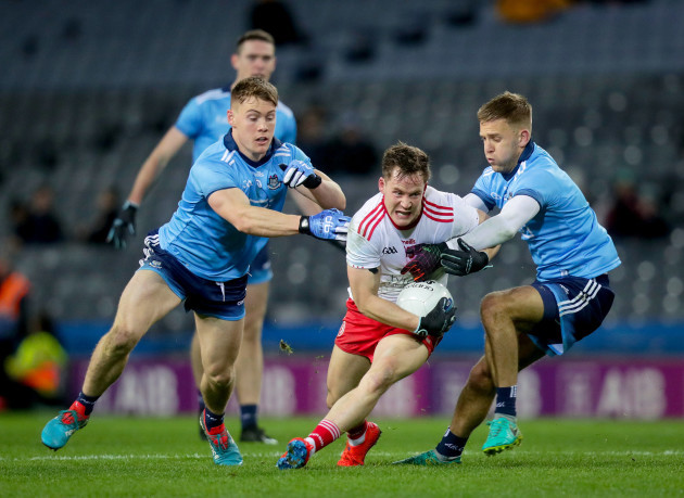 Jonny Cooper and Con O'Callaghan tackle Kieran McGeary