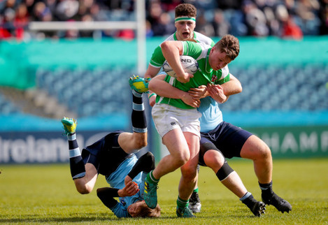 Ronan Shaw is tackled by Niall Carroll and Fionn Finlay