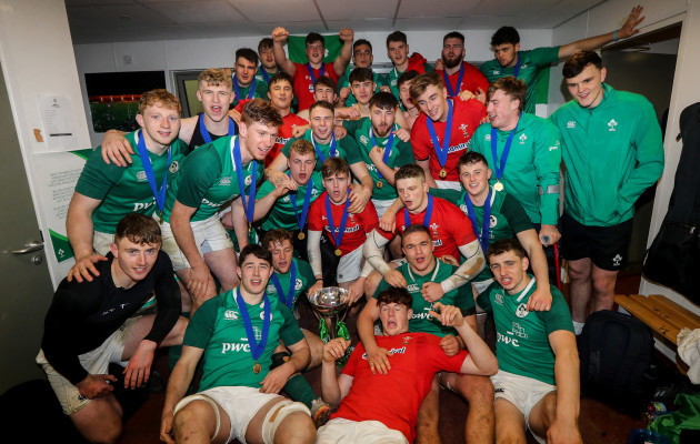 Ireland players celebrate with the trophy in the dressing room after the game