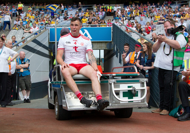 Cathal McCarron leaves the field injured