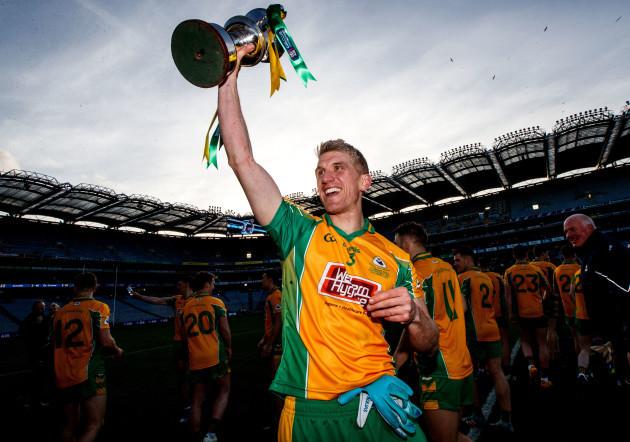 Kieran Fitzgerald lifts the Andy Merrigan Cup