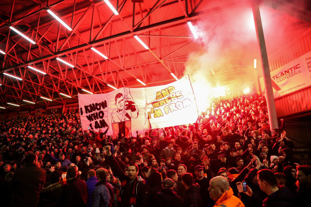 Bohemians fans light flares before the game