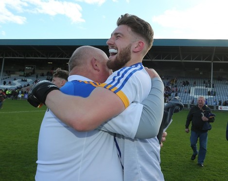 John Evans and Mark Jackson celebrate at the final whistle
