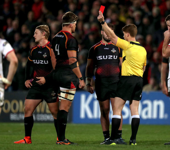 Lloyd Linton shows Tertius Kruger a red card