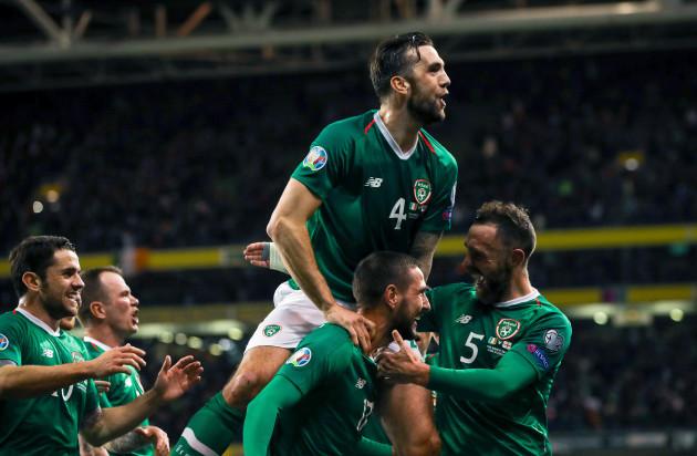 Conor Hourihane celebrates scoring a goal with Robbie Brady, Shane Duffy and Richard Keogh