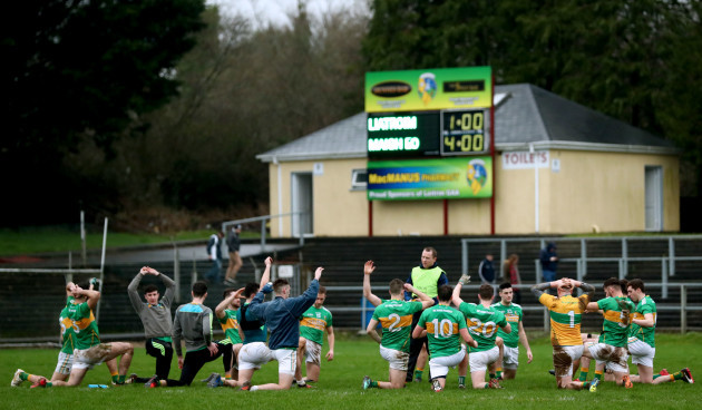 The Leitrim team warm down with the final score from the penalty shoot out on the scoreboard
