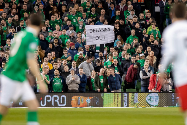 A fan holds a banner in protest of FAI Executive Vice President John Delaney