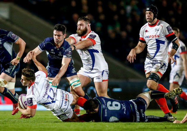 Rohan Janse van Rensburg is tackled by Eoghan Masterson and Paul Boyle