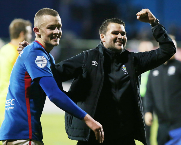 Michael O'Connor and David Healy celebrate after the match