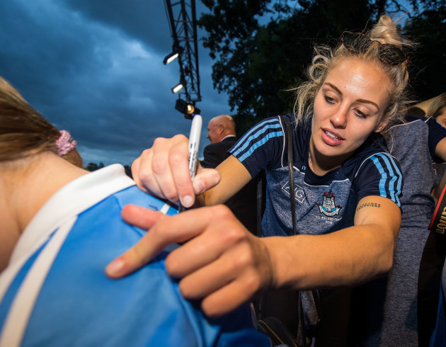 Nicole Owens signs a jersey