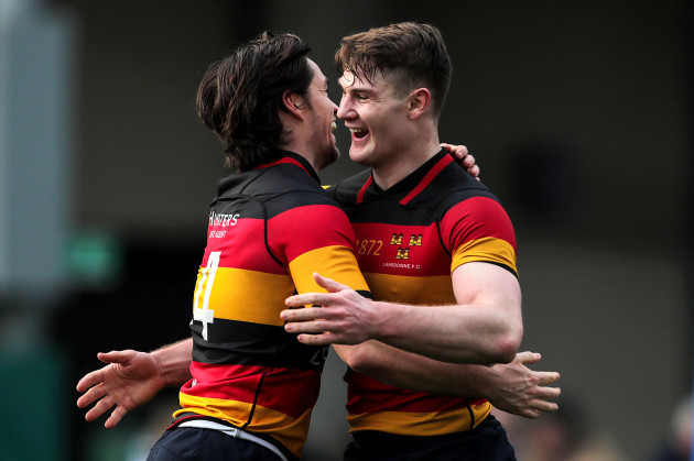 Daniel McEvoy celebrates scoring a try with Peter Sullivan