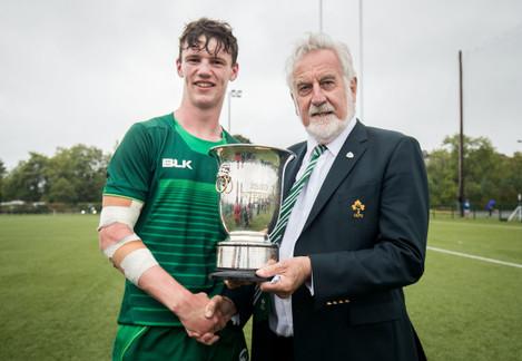 Darragh Murray receives the trophy from Adrian Leddy