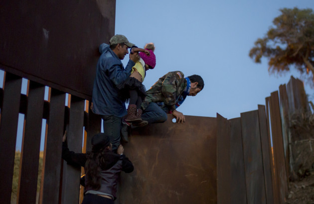 Migrants cross the border to the USA