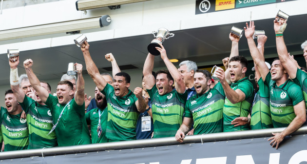Billy Dardis lifts the trophy and celebrates winning the final with teammates